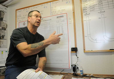 Nevin Larsen, a consultant and company hand for Whiting Petroleum Corp., shows data inside of his office at an oil drilling rig site southwest of Belfield, N.D., on Monday, April 22, 2013.