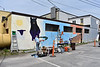 HOLLY PELCZYNSKI- BENNINGTON BANNER Cristal Call adds paint to the Union St. mural on Wednesday on 108 Union St. in Bennington.