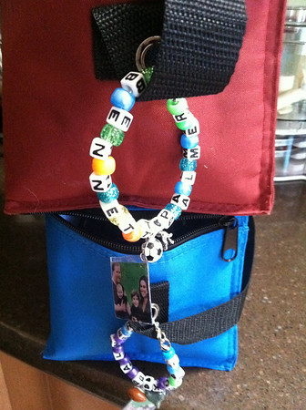 """Aren't these great? Andrea writes, """" My 4 year old and I made them, each kid got to pick 2 charms - 4 year old picked football and shark, 2 year old picked doggy and soccer ball. We made the photo holders out of an old plastic container. 4 year old picked his bead colors and helped me string both. It was fun!"""""""