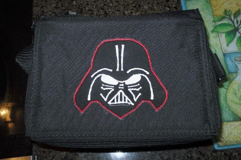 "Andrea P. shared this on our Facebook wall: My boy is getting a Darth Vader backpack for kindergarten, so I made a Darth Vader patch and glued it on his ELB cooler to carry to school."" Thanks Andrea! So cool!"