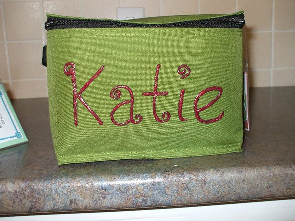 """Kim sent me this pic and she wrote, """"I was worried that my second grader and kindergartener would not like the plain design, but they picked out the color of their lunchbox and I added their name with fabric paint. It turned out great, and we are going to add flowers and butterflies soon, now that we know the paint will stick. They love them!"""""""