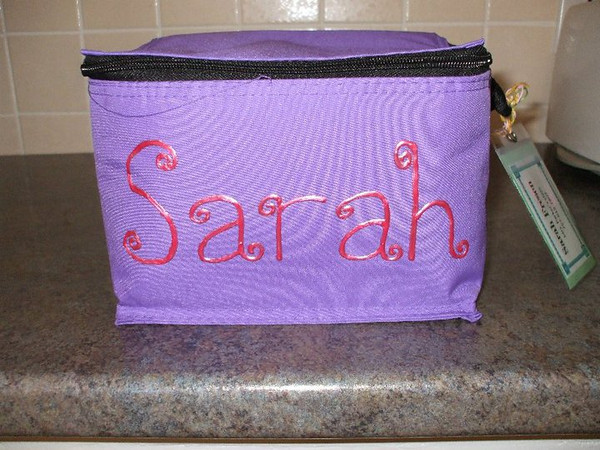 "Kim sent me this pic and she wrote, ""I was worried that my second grader and kindergartener would not like the plain design, but they picked out the color of their lunchbox and I added their name with fabric paint. It turned out great, and we are going to add flowers and butterflies soon, now that we know the paint will stick. They love them!"""