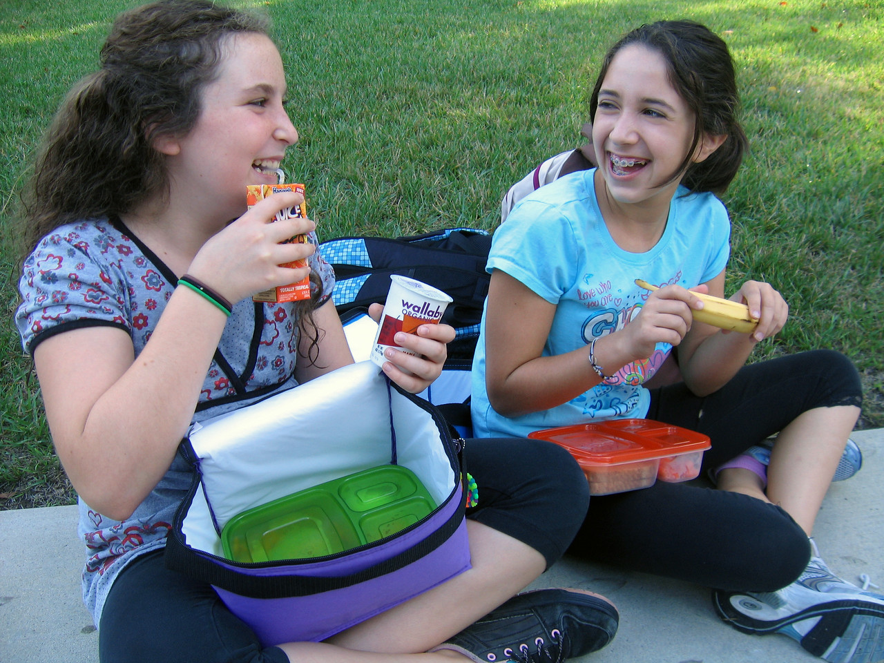 Hi Res Middle School girls enjoying lunch