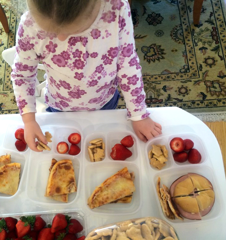 Child packing lunch
