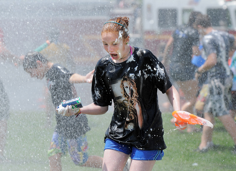 be0623waterfight01.jpg <br /> Emma Shileny, 11, reacts while beign hit with water sprayed on the students by North Metro Fire Rescue firefighters during the water fight marking the last day of the Totus Tuus program at Nativity of Our Lord Church and School on Friday.<br /> June 17, 2011<br /> staff photo/David R. Jennings