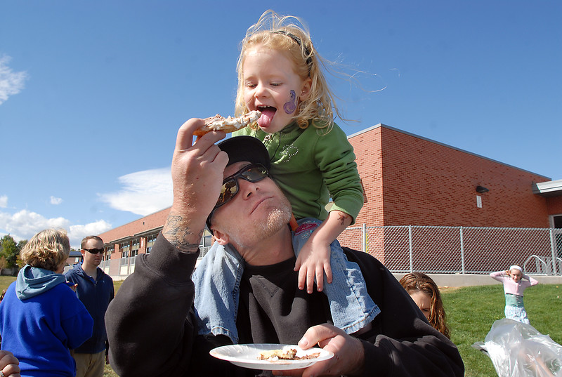 be1014mview01.jpg BE1014mview01<br /> Dennett Marston shares a piece of pie with his daughter Maggie, 3,  during Mtn. View Elementary School's 30th anniversary celebration and fall festival on Saturday.<br /> October 9, 2010<br /> staff photo/David R. Jennings