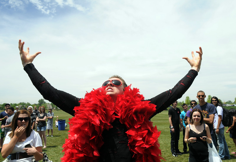 BE0530BSTOCK01.jpg BE0530BSTOCK01<br /> Carter James, 21, dance wearing a red boa during Thursday's Broomstock 2010 at the Broomfield County Commons. <br /> May 27, 2010<br /> Staff photo/ David R. Jennings
