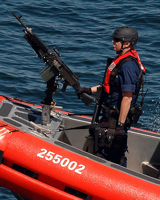 Coast Guard gunboats patrol Puget Sound this weekend escorting Washington State Ferries due to the heightened threat level.