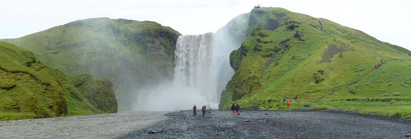skógafoss is astonishing. It just thunders over the sheer cliff and you can walk as close as you like to the downpour... providing you like to get soaked by spray. The noise is heart stopping. Then you can climb up to the top and take in the views from there while seagulls wheel around you. Wonderful... but we had miserable drizzly weather.