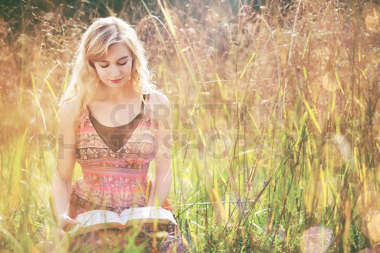 Reading Bible in field