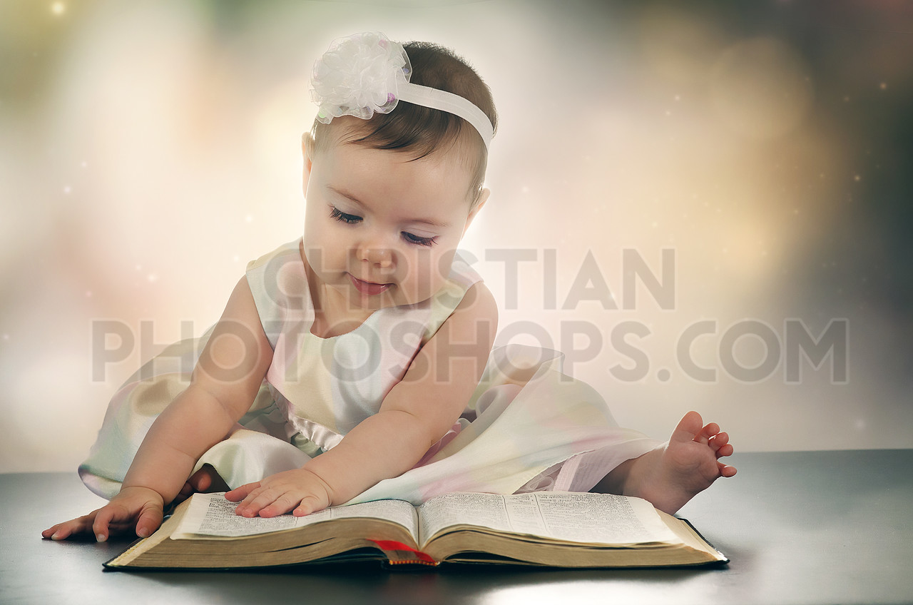 Young baby girl and Bible