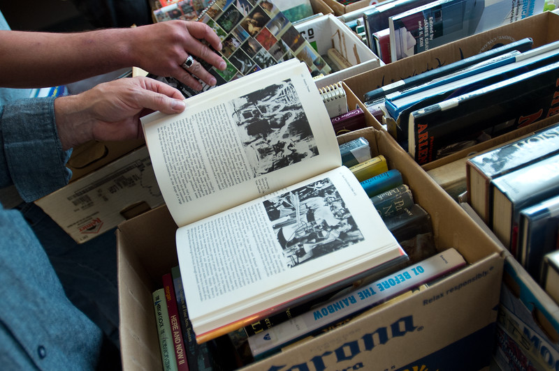 "Craig Nagus looks through art books during The Big One Book Sale at the Longmont Public Library on Sunday. <br /> More photos:  <a href=""http://www.dailycamera.com"">http://www.dailycamera.com</a><br /> Autumn Parry/Staff Photographer<br /> April 24, 2016"
