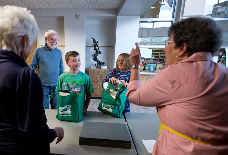 "Rolf McHenry (left) pays for books with his grandchildren Gavin McHenry, 10, and  Natalee Anderson, 11,  during The Big One Book Sale at the Longmont Public Library on Sunday. Sunday's special included a bag of books for only five dollars. <br /> More photos:  <a href=""http://www.dailycamera.com"">http://www.dailycamera.com</a><br /> Autumn Parry/Staff Photographer<br /> April 24, 2016"