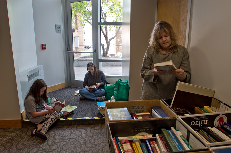 "Danica Moen, 9, (left) reads ""Full House"" during The Big One Book Sale at the Longmont Public Library on Sunday. <br /> More photos:  <a href=""http://www.dailycamera.com"">http://www.dailycamera.com</a><br /> Autumn Parry/Staff Photographer<br /> April 24, 2016"