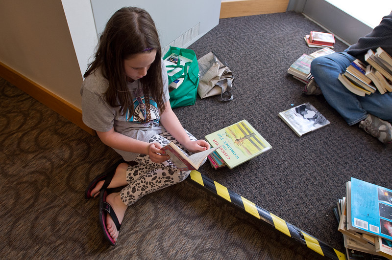 "Danica Moen, 9, reads ""Full House"" during The Big One Book Sale at the Longmont Public Library on Sunday. <br /> More photos:  <a href=""http://www.dailycamera.com"">http://www.dailycamera.com</a><br /> Autumn Parry/Staff Photographer<br /> April 24, 2016"