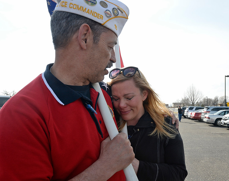 Tony Dumosh with the American Legion Post 15 Loveland, comforts his friend, Amy Hosterman, as she gets emotional before lining the street as a hearse carrying the body of U.S. Marine Riley Schultz arrives at Immanuel Lutheran Church on Thursday, March 28, 2019, in Loveland. (Photo by Jenny Sparks/Loveland Reporter-Herald)