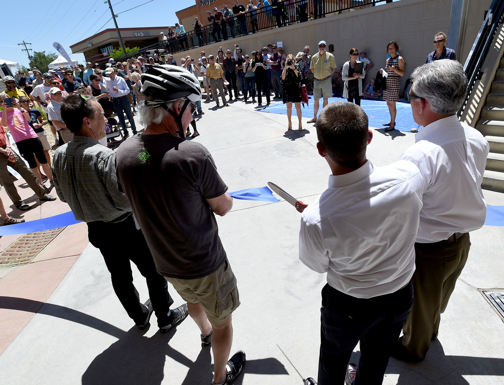 . Boulder City Councilman, Matt Appelbaum, with bike helmet, was among dignitaries cutting the ribbon for the new underpass. The Boulder Bike Underpass Choir performed at the Baseline Road Underpass Opening on Thursday. For more photos and a video, go to www.dailycamera.com.  Cliff Grassmick  Staff Photographer June 15, 2017