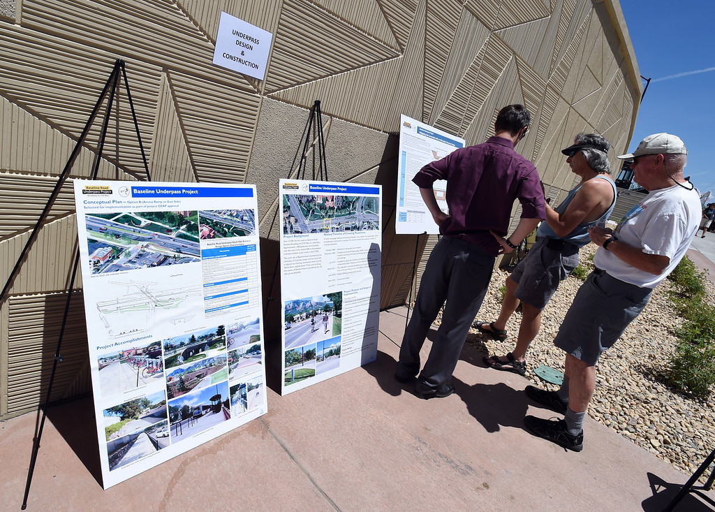 . People look over diagrams of the Baseline Underpass Project. The Boulder Bike Underpass Choir performed at the Baseline Road Underpass Opening on Thursday. For more photos and a video, go to www.dailycamera.com.  Cliff Grassmick  Staff Photographer June 15, 2017