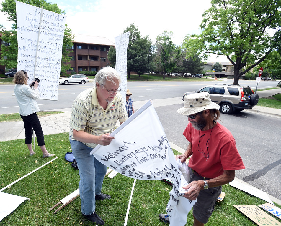 . Matt Nicodermus, left, and Frank Hogg, put together Walmart protest signs, celebrating that the Boulder store is closing. For more photos and a video, go to www.dailycamera.com.  Cliff Grassmick  Staff Photographer June 16, 2017