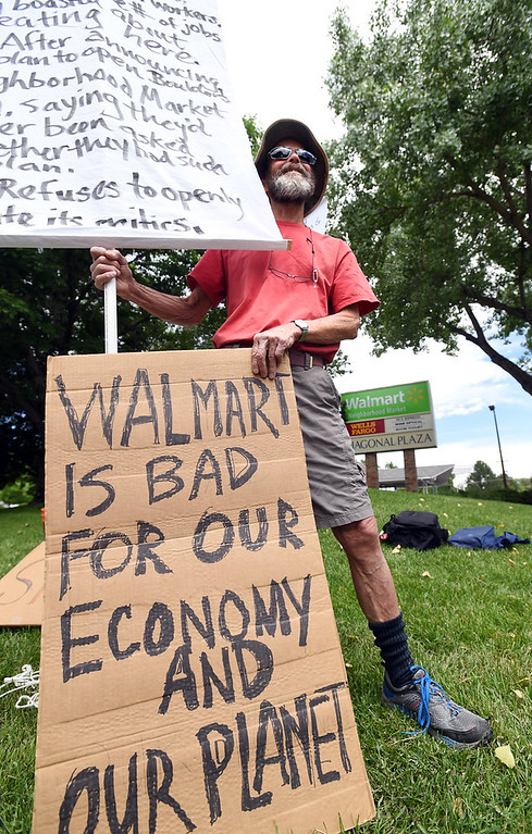 . Frank Hogg was among five people celebrating the fact that the  Walmart Neighborhood Market in Boulder is closed as of Friday.  For more photos and a video, go to www.dailycamera.com.  Cliff Grassmick  Staff Photographer June 16, 2017