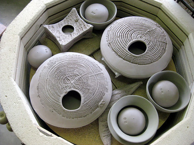 Pots can be nested and touching in a bisque firing and will be slowly heated to 1750 degrees F and cooled slowly, before the glazes are applied.