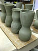 Other vases have fluting or carving made with a sharp tool.