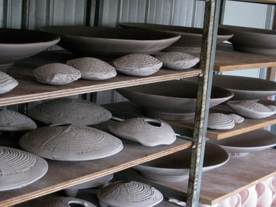 """Daphne's 20"""" platters are drying along with the """"sylph"""" forms, awaiting the kiln."""