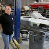 Shawsheen Valley Technical High School student Maren Williams from Tewksbury talks about the 1967 classic Corvettes, behind her, that she is helping to restore at her co-op at The Bowtie Shop in Billerica. SUN/JOHN LOVE
