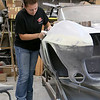Shawsheen Valley Technical High School student Maren Williams from Tewksbury works on a 1967 classic Corvettes that she is helping to restore at her co-op at The Bowtie Shop in Billerica. SUN/JOHN LOVE