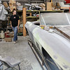 Shawsheen Valley Technical High School student Maren Williams from Tewksbury stands near the 1967 classic Corvettes that she is helping to restore at her co-op at The Bowtie Shop in Billerica. SUN/JOHN LOVE