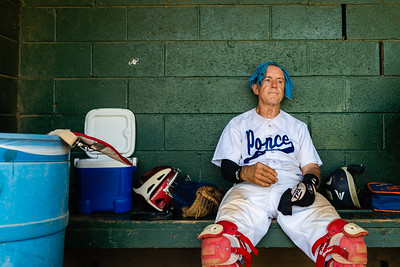 "Mark ""Bulldog"" Pizzo, 70, cools off with a cold towel after playing catcher in a championship baseball game on June 30, 2019."