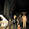 The family walking through the huge airplane