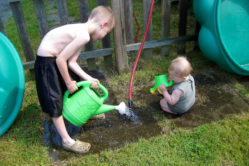 Watering the walkway with the hope that mud will grow