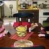 Hayden and Koben sitting at the table chatting on their DS's