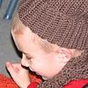 Koben wearing Meem's handmade scarf and hat