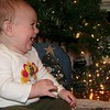 Laughing at the Christmas ornaments