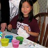 Carley coloring her eggs