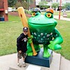 Koben with one of the many frog statues in Erie