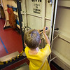Koben learning to latch the door on the USCGC Taney