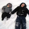 Brothers laying in the snow