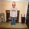 Koben after school with his birthday boy sticker and hat