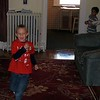 The boys playing tag in the house
