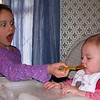 Malee feeding Nolan and appears to be very excited about it