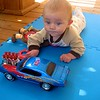 Nolan playing with the car