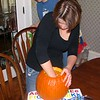 Mom helping to clean out the pumpkin