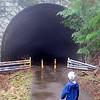 Koben looking into the creepy, fog consumed tunnel