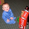 Nolan playing with the Coke boxes and a bowl while Mom gets dinner ready