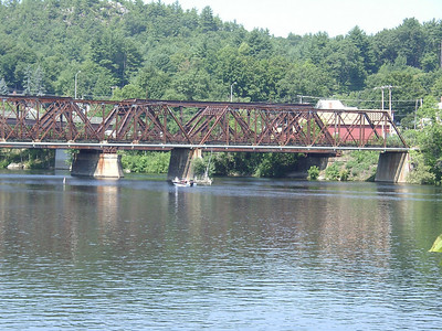 Looking downstream along this westerly-flowing section of the Merrimack. The massive railroad truss makes the Lilac bridge look more frail.