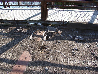 Closer inspection of the deck suggests why the bridge is fenced off.