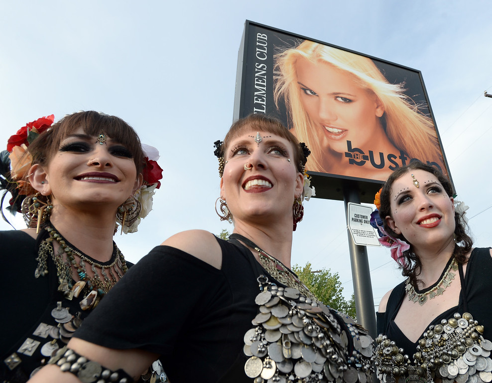 . BOULDER, CO - SEPTEMBER 29:  Steph Maes, left, Jennifer Seacrest Goran, and Mirav Levy, pose in front of the Bustop sign for a photographer at the event. A celebration of dance was held at the Bustop to mark the occasion of the closing of the establishment on Saturday in Boulder.(Photo by Cliff Grassmick/Staff Photographer))